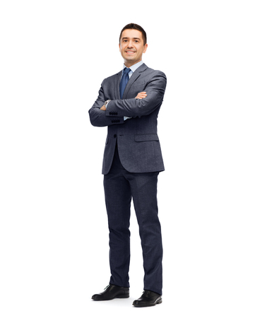 men standing: business, people and office concept - happy smiling businessman in dark grey suit