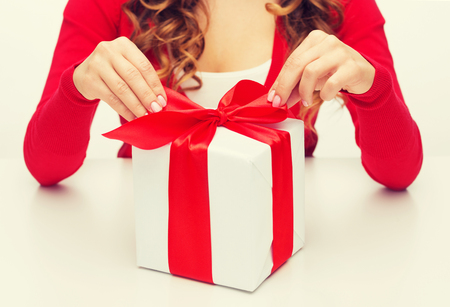 gift ribbon: christmas, x-mas, happiness, winter and people concept - woman hands opening gift box