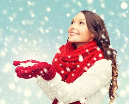 big woman: winter, people, happiness concept - woman in scarf and gloves with big snowflake