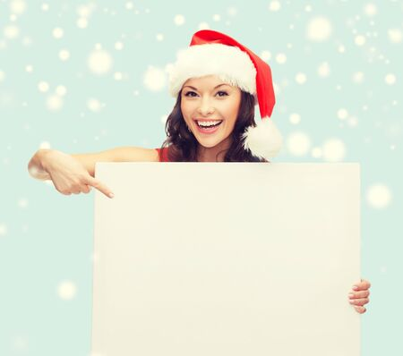 cute lady: christmas, x-mas, people, advertisement, sale concept - happy woman in santa helper hat with blank white board