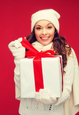 woman: christmas, x-mas, winter, happiness concept - smiling woman in white clothes with gift box