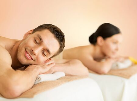 men and women: picture of couple in spa salon lying on the massage desks