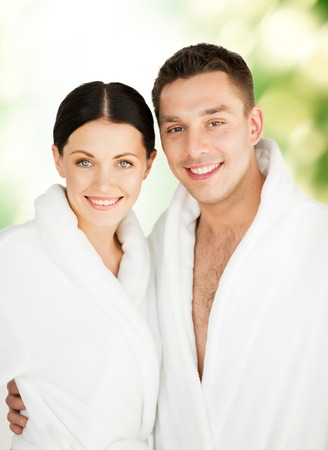 happy young couple: picture of couple in spa salon in white bathrobes Stock Photo