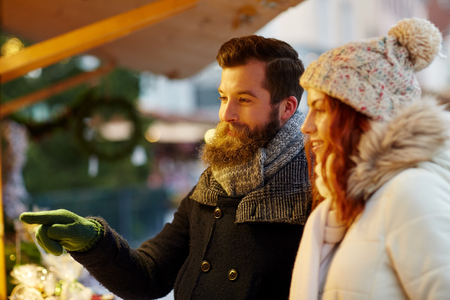 fair woman: holidays, winter, christmas and people concept - happy couple in warm clothes outdoors
