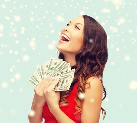 lady in red: christmas, x-mas, sale, banking concept - smiling woman in red dress with us dollar money