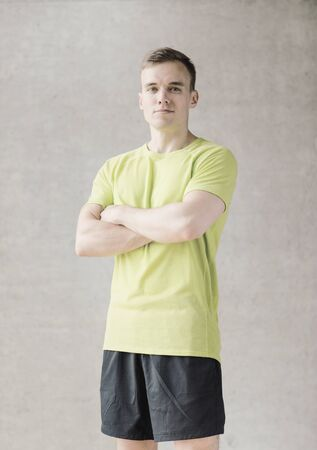 male body: sport, fitness, lifestyle and people concept - smiling man in gym
