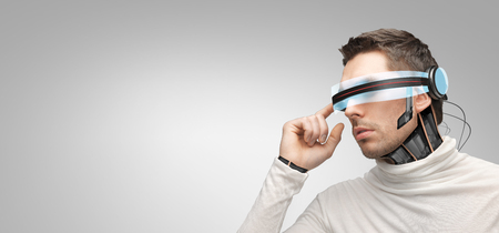 blank space: people, technology, future and progress - man with futuristic 3d glasses and microchip implant or sensors over gray background