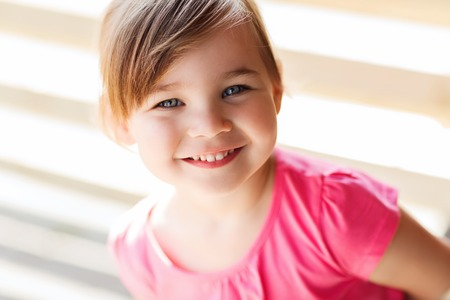 summer, childhood, happiness and people concept - happy beautiful little girl portrait
