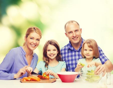 comida, familia, hijos, la felicidad y el concepto de la gente - familia feliz con dos niños haciendo la cena en casa