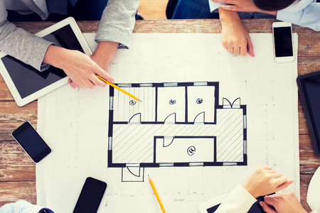 Business people technology and team work concept close up business people technology and team work concept close up of architects with blueprint malvernweather Image collections