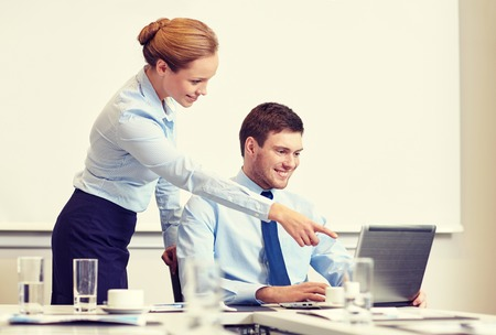 secretary: business, people and work concept - businessman and secretary with laptop working in office Stock Photo