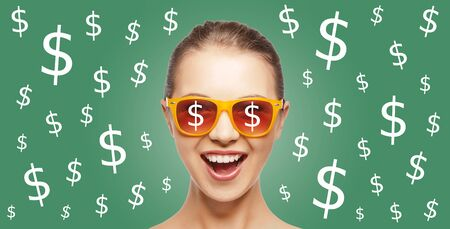 holiday profits: people, finance and money concept - happy screaming teenage girl in shades over green background with dollar currency sings
