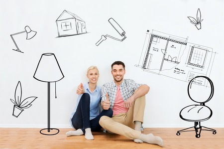 home, people, repair, moving and real estate concept - happy couple sitting on floor and showing thumbs up at new place over interior doodles background Foto de archivo