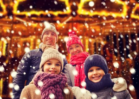 winter clothing: family, childhood, season and people concept - happy family outdoors