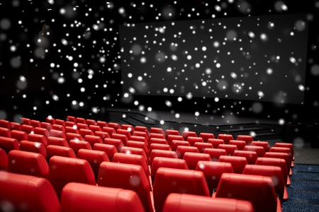 entertainment concept: entertainment and leisure concept - movie theater or cinema empty auditorium with red seats over snowflakes