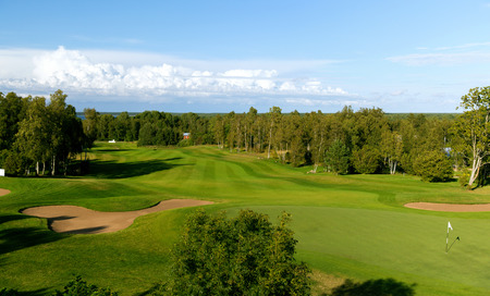 game, entertainment, sport and leisure concept - natural landscape with golf field or course view Archivio Fotografico