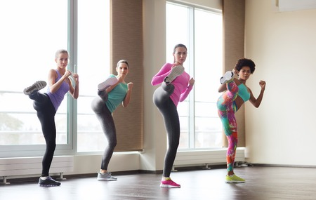 gym class: fitness, sport, training, gym and martial arts concept - group of women working out and fighting in gym Stock Photo
