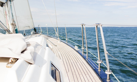 deck: vacation, travel, cruise and leisure concept - close up of sailboat or sailing yacht deck and sea Stock Photo