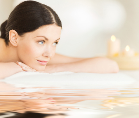 female beauty: picture of happy relaxed woman in spa salon