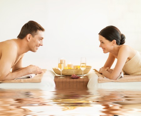 spa woman: picture of couple in spa salon drinking champagne