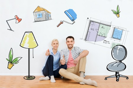 move in: home, people, repair, moving and real estate concept - happy couple sitting on floor and showing thumbs up at new place over interior doodles background Stock Photo