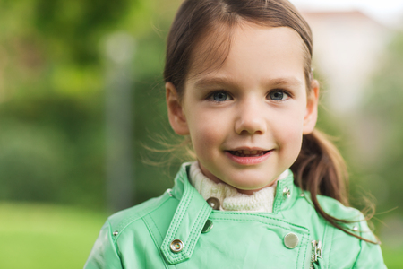 beautiful preteen girl: summer, childhood, happiness and people concept - happy beautiful little girl portrait outdoors Stock Photo