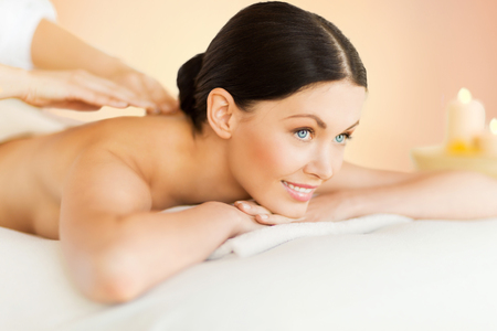 relaxation massage: picture of woman in spa salon getting massage Stock Photo