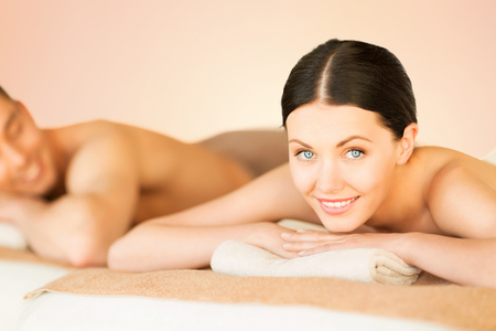 beauty and health: picture of couple in spa salon lying on the massage desks