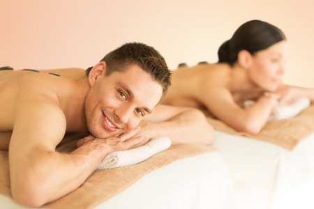 spa: picture of couple in spa salon with hot stones