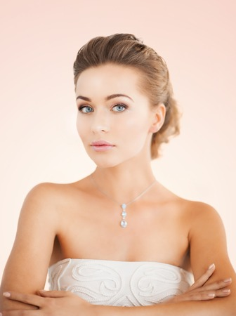 shimmering: beautiful woman in white dress with diamond necklace