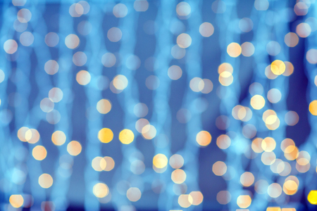party background: holidays, party and celebration concept - blurred golden lights background