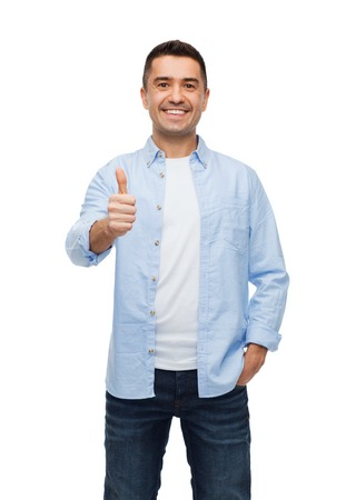 thumbs up business: happiness, gesture and people concept - smiling man showing thumbs up