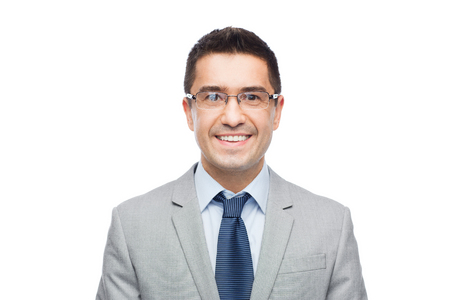 white suit: business, people, vision and office concept - happy smiling businessman in eyeglasses and suit Stock Photo