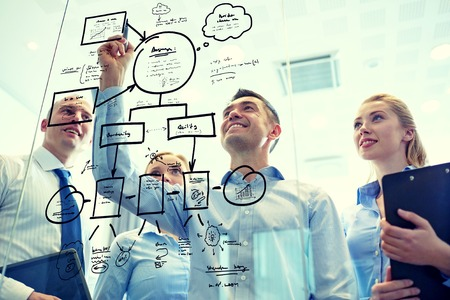 people office: business, people, teamwork and planning concept - smiling business team with marker and stickers working in office Stock Photo