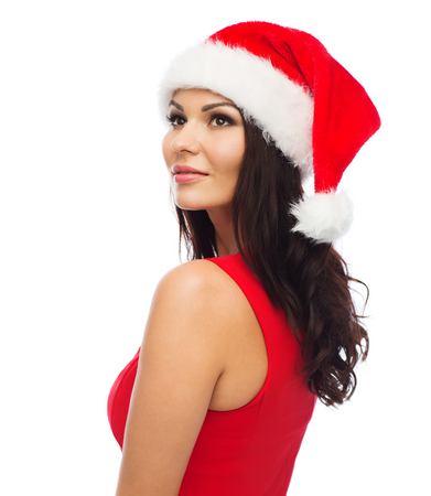 hat nude: people, holidays, christmas and celebration concept - beautiful sexy woman in santa hat and red dress