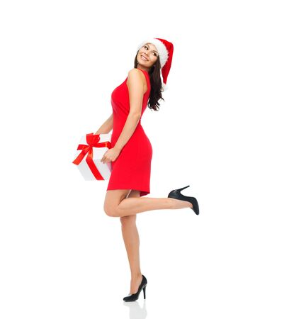 nude young woman: people, holidays, christmas and celebration concept - beautiful sexy woman in red dress and santa hat with gift box