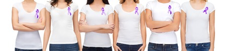 gynecologic: charity, people, health care and social issue concept - close up of woman with purple domestic violence awareness ribbon on her chest