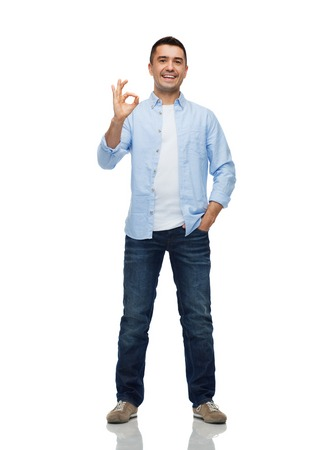 ok hand: happiness, gesture and people concept - smiling man showing ok hand sign Stock Photo