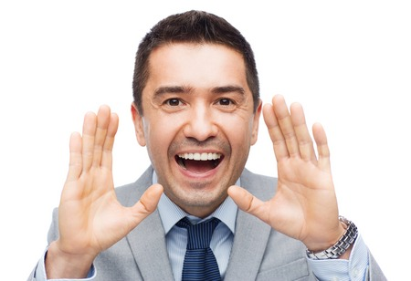 public speaking: business, people and public announcement concept - happy businessman in suit shouting