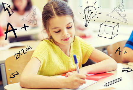 group of school kids with notebooks writing test in classroom over doodles