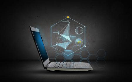 tecnología informatica: tecnología y futuro concepto - ordenador portátil abierto con la proyección gráfica virtual sobre fondo gris oscuro