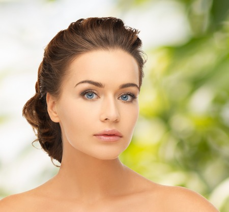 updo: health and beauty concept - face of beautiful bride with evening updo