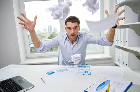 throw paper: business, people, stress, emotions and fail concept - angry businessman throwing papers in office Stock Photo