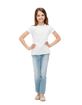 school teens: childhood, fashion, advertisement and people concept - smiling little girl in casual clothes Stock Photo
