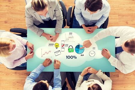 success in business: business, people, statistics, success and team work concept - close up of business group with charts and start up icons sitting at table in office