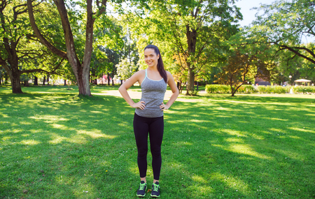slim girl: fitness, sport, people and healthy lifestyle concept - happy young woman exercising outdoors