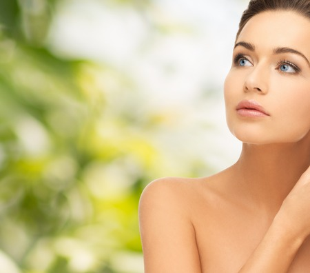 beautiful eyes: beauty and health concept - beautiful woman looking up