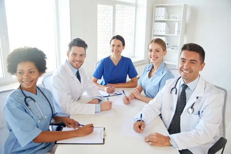 medical education: hospital, medical education, health care, people and medicine concept - group of happy doctors meeting at medical office