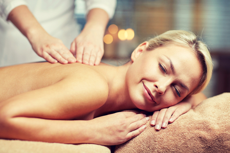 massagist: people, beauty, spa, healthy lifestyle and relaxation concept - close up of beautiful young woman lying with closed eyes and having hand massage in spa