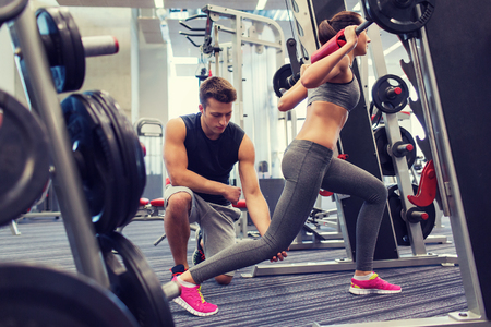 sport, fitness, teamwork, weightlifting and people concept - young man and personal trainer with barbell flexing muscles in gym 스톡 콘텐츠